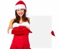 圣诞老人帮手有横幅的圣诞节女孩。 免版税图库摄影