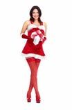 圣诞老人帮手有礼物的圣诞节女孩。 免版税库存照片