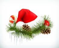 圣诞老人帽子、圣诞树和锥体 库存图片