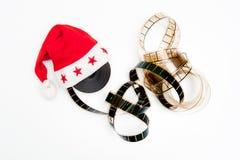 圣诞老人帽子和影片轴 库存图片