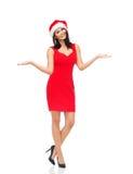 圣诞老人帽子和红色礼服的美丽的性感的妇女 库存图片