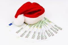 圣诞老人帽子和货币 免版税图库摄影