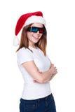 圣诞老人帽子和3d玻璃的快乐的女孩 库存图片