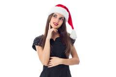 圣诞老人帽子微笑的深色的女孩 库存图片
