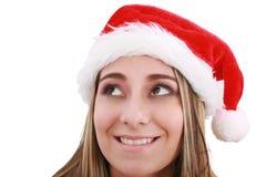 圣诞老人帽子的一个性感的女孩 库存照片