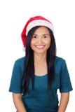 戴圣诞老人帽子的亚裔妇女 免版税库存图片