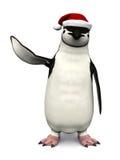 戴圣诞老人帽子的企鹅 免版税库存照片