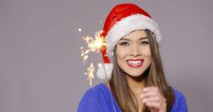 圣诞老人帽子的华美的性感的少妇 免版税库存照片