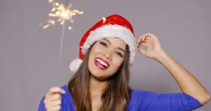 圣诞老人帽子的华美的性感的少妇 库存照片