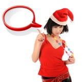 圣诞老人帽子的女孩有讲话泡影的。 图库摄影