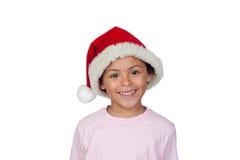 戴圣诞老人帽子的女孩的画象 免版税库存图片