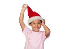 戴圣诞老人帽子的女孩的画象 图库摄影