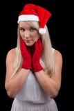 圣诞老人帽子的女孩 免版税库存图片