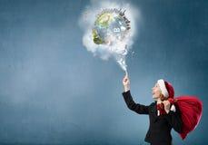 圣诞老人帽子的女实业家 库存照片