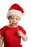 圣诞老人帽子的婴孩与棒棒糖 库存照片