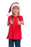 圣诞老人帽子的小女孩 免版税图库摄影