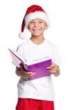 圣诞老人帽子的小男孩 库存照片