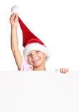 圣诞老人帽子的小男孩 免版税图库摄影
