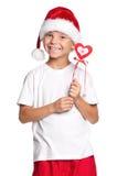 圣诞老人帽子的小男孩 库存图片
