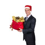 圣诞老人帽子的年轻人 免版税图库摄影