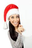 圣诞老人帽子的微笑的女孩。隔绝 免版税图库摄影