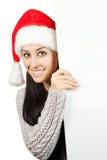 圣诞老人帽子的微笑的女孩。隔绝 库存图片