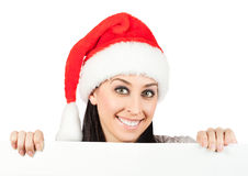 圣诞老人帽子的微笑的女孩。 查出 免版税图库摄影