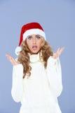 圣诞老人帽子的性感的妇女用被举的手 图库摄影