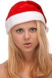 圣诞老人帽子的新白肤金发的妇女 免版税图库摄影