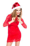 圣诞老人帽子的激动的妇女有握紧拳头的 库存图片