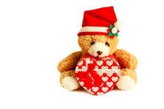 戴圣诞老人帽子的玩具熊 免版税图库摄影