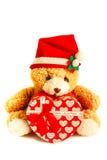 戴圣诞老人帽子的玩具熊 库存图片