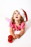圣诞老人帽子的甜婴孩    免版税库存照片