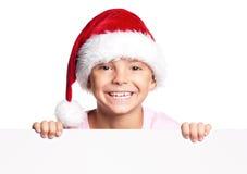 圣诞老人帽子的男孩 免版税图库摄影