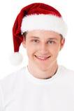 戴圣诞老人帽子的男孩 免版税库存照片
