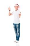 戴圣诞老人帽子的男孩 库存照片