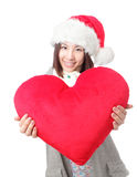 圣诞老人帽子的美丽的女孩 免版税库存图片