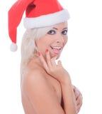 圣诞老人帽子的裸体圣诞节妇女 图库摄影