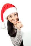 圣诞老人帽子的逗人喜爱的女孩。 查出 免版税图库摄影