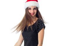 圣诞老人帽子的逗人喜爱的女孩 免版税库存图片