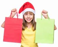 戴圣诞老人帽子的逗人喜爱的女孩 免版税库存照片