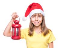 戴圣诞老人帽子的逗人喜爱的女孩 库存图片