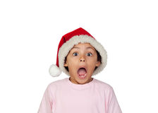 戴圣诞老人帽子的震惊女孩 免版税库存照片