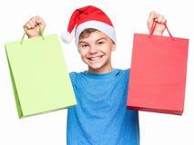 戴圣诞老人帽子的青少年的男孩 库存图片