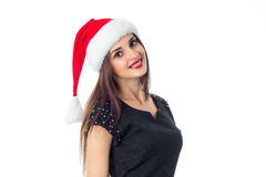 圣诞老人帽子的年轻可爱的女孩 库存照片