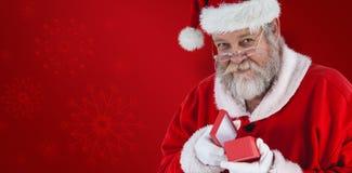圣诞老人开头圣诞节礼物特写镜头的综合图象  免版税库存图片