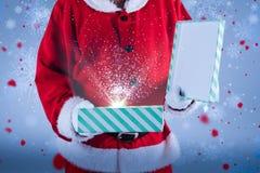 圣诞老人开头礼物盒的中央部位的综合图象 免版税图库摄影