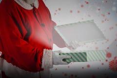 圣诞老人开头礼物盒的综合图象 图库摄影