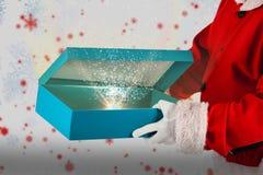 圣诞老人开头礼物盒的综合图象 免版税库存照片