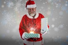 圣诞老人开头礼物盒的综合图象 库存照片